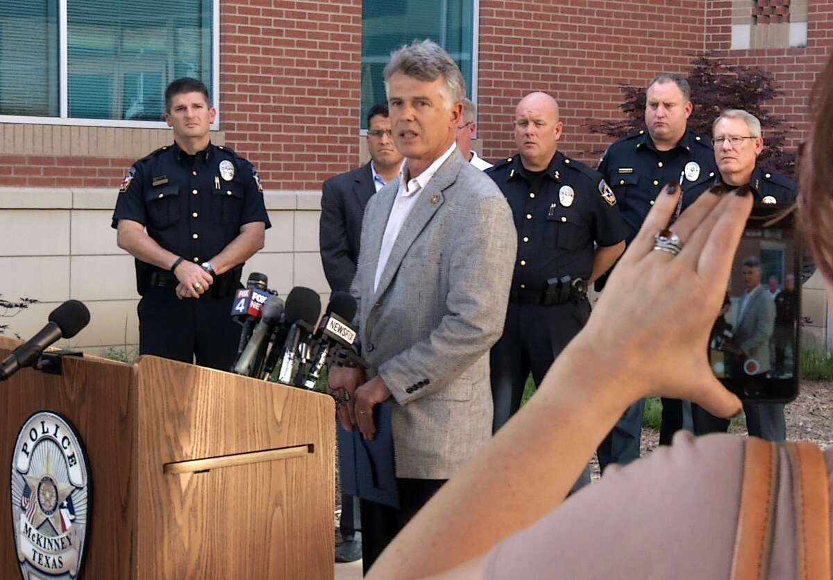 In this frame from video, McKinney Mayor Brian Loughmiller speaks at a news conference at police headquarters, Tuesday, June 9, 2015, in McKinney, Texas. The white police officer who was recorded on video pushing a black girl to the ground at a North Texas pool party resigned from the police force Tuesday. (AP Photo/Jill Craig)