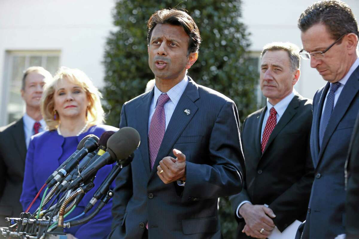 Louisiana Gov. Bobby Jindal, center, speaks to reporters outside the White House in Washington, Monday, Feb. 24, 2014, following a meeting between President Barack Obama and members of the National Governors Association (NGA). At right is Connecticut Gov. Dannel P. Malloy. Also pictured, from left are, Maryland Gov. Martin O'Malley, NGA Chair, Oklahoma Gov. Mary Fallin, and Vermont Gov. Peter Shumlin. (AP Photo/Charles Dharapak)