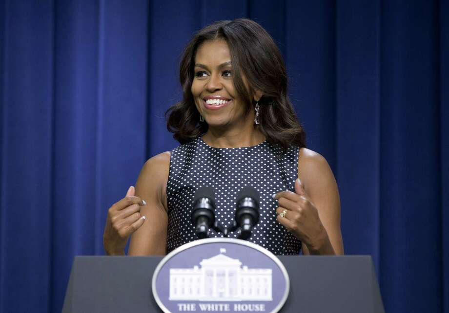 This photo taken Sept. 16, 2015, shows First lady Michelle Obama speaking in the South Court Auditorium of Eisenhower Executive Office Building on the White House complex in Washington.  The first lady is paying a visit to the childrenís animated series ìDoc McStuffins.î In the episode, the cartoon Mrs. Obama invites Doc and other kids who are making a difference in their communities to the White House to be honored. Doc receives special recognition when the first lady appoints her the official toy doctor for the White House. The episode featuring Mrs. Obama airs Monday, Oct. 5, which is Child Health Day in the United States. Photo: AP Photo/Carolyn Kaster, File   / AP