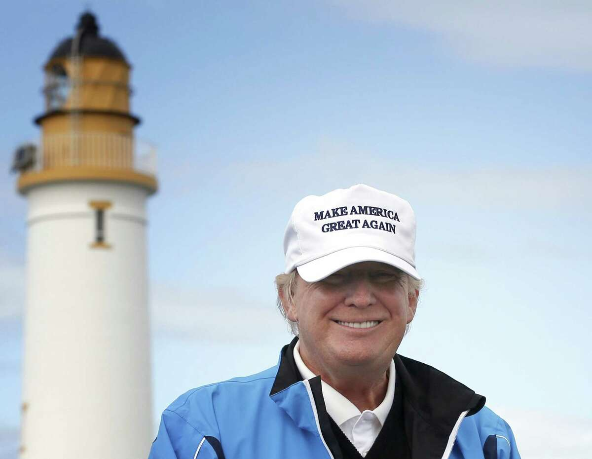 In this Aug. 1, 2015 photo, Republican presidential candidate Donald Trump poses for the media during the third day of the Women's British Open golf championship on Trump's Turnberry golf course in Turnberry, Scotland.