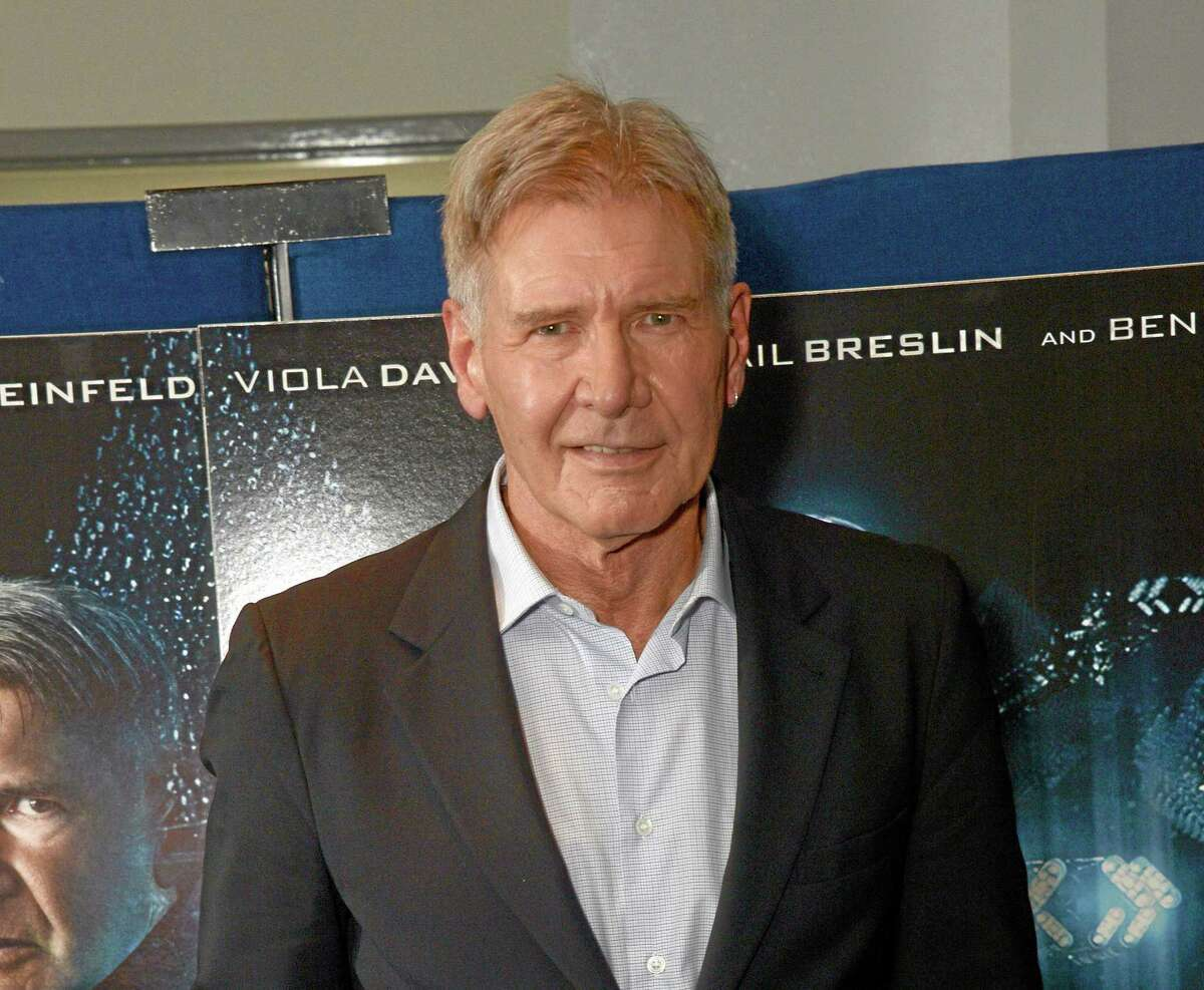 """In this Oct. 7, 2013 file photo, Harrison Ford poses for the """"Enders Game"""" photo call in London. Ford has been injured on the set of """"Star Wars: Episode VI"""" and was taken to a hospital. Disney said the 71-year-old actor was being treated for an ankle injury that happened during filming Thursday, June 12, 2014."""