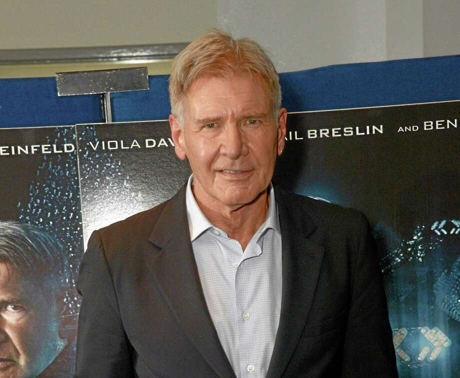 "In this Oct. 7, 2013 file photo, Harrison Ford poses for the ""Enders Game"" photo call in London. Ford has been injured on the set of ""Star Wars: Episode VI"" and was taken to a hospital. Disney said the 71-year-old actor was being treated for an ankle injury that happened during filming Thursday, June 12, 2014. Photo: Associated Press  / Invision"