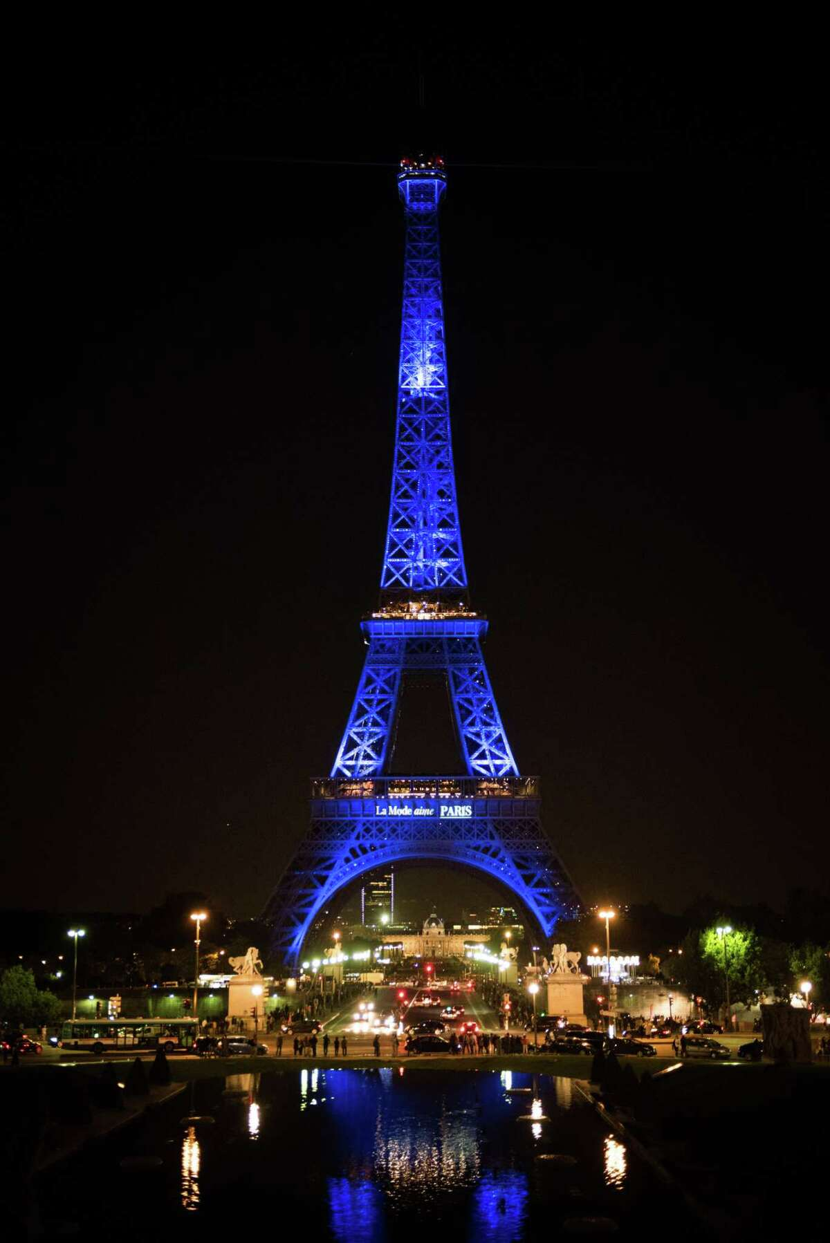 The Eiffel Tower is illuminated in the colors of