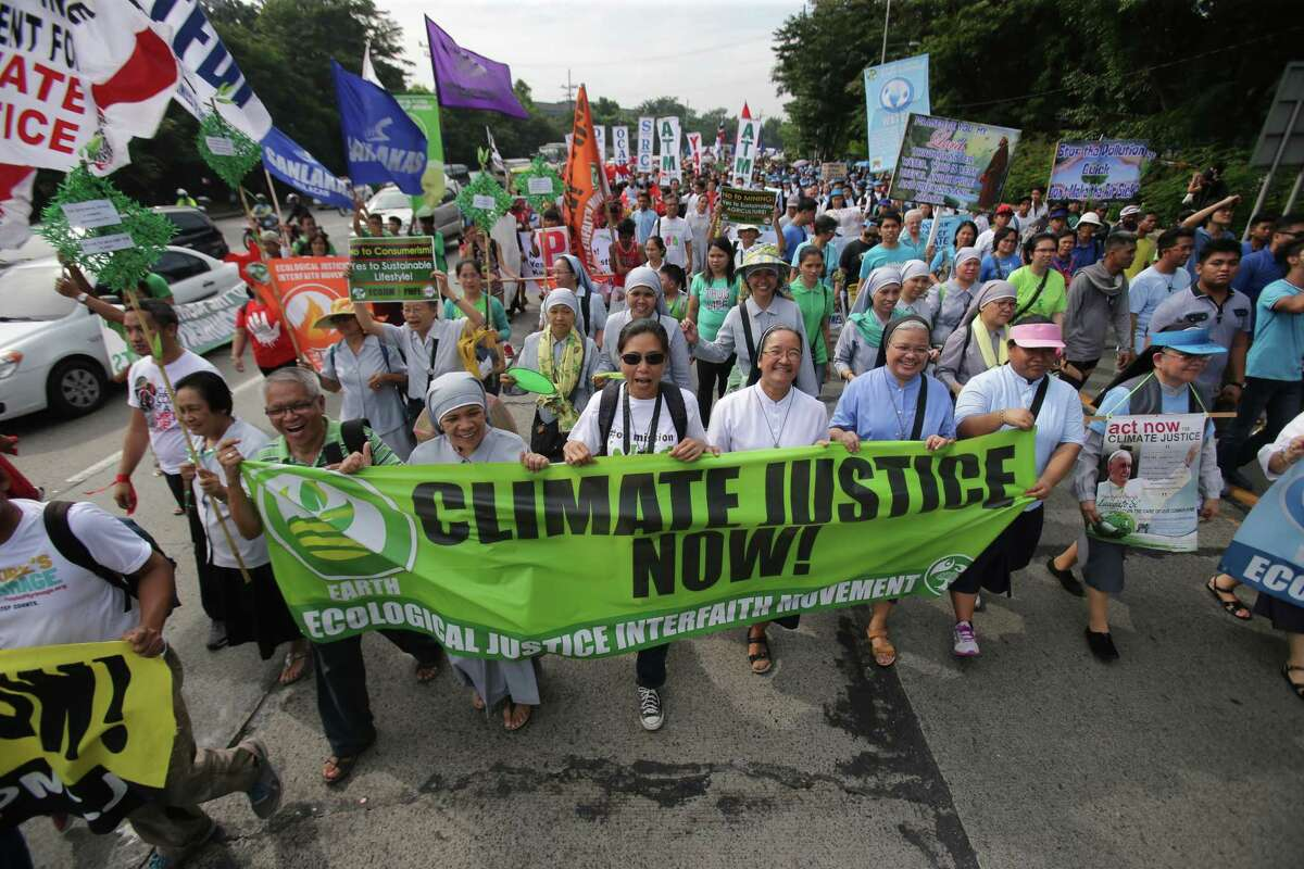 Filipino nuns and priests, along with Catholic groups, lead a march to raise awareness on the dangers of climate change in suburban Quezon city, north of Manila, Philippines.