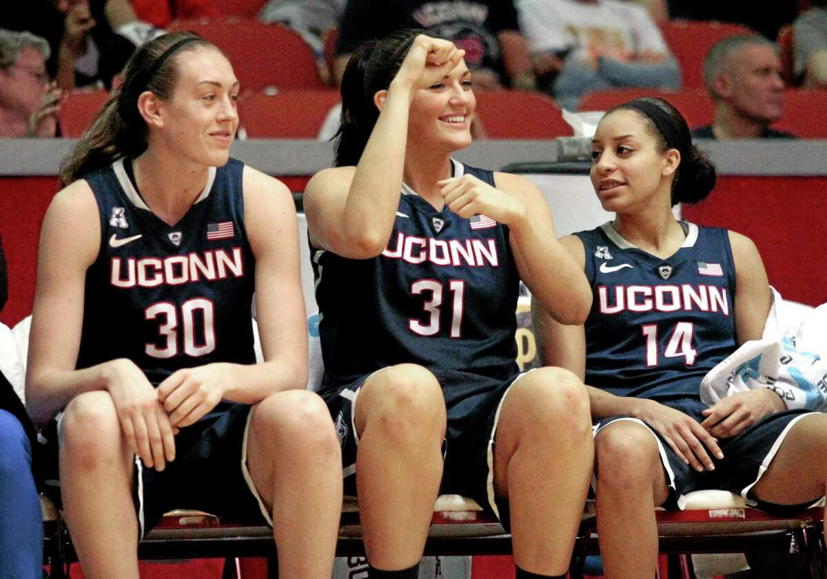 UConn sophomore Breanna Stewart, left, cheers from the bench with seniors Stefanie Dolson, center, and Bria Hartley during Saturday's win over Houston.
