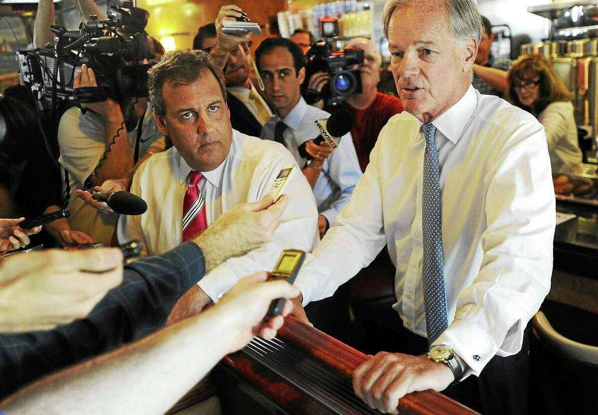 Connecticut Republican gubernatorial candidate Tom Foley, right, answers questions from the media as New Jersey Gov. Chris Christie, left, looks on, at a diner on July 21, 2014, in Greenwich, Conn.