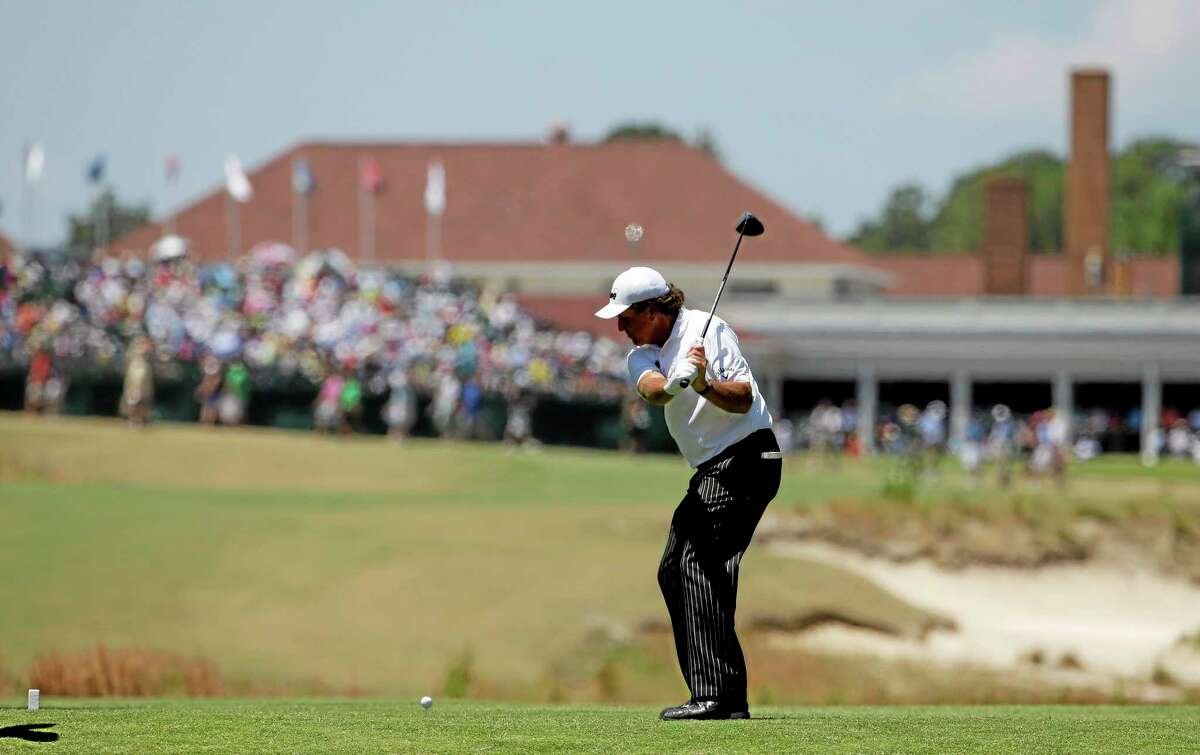 Phil Mickelson hits his tee shot on the 18th hole during a practice round for the U.S. Open Tuesday in Pinehurst, North Carolina.