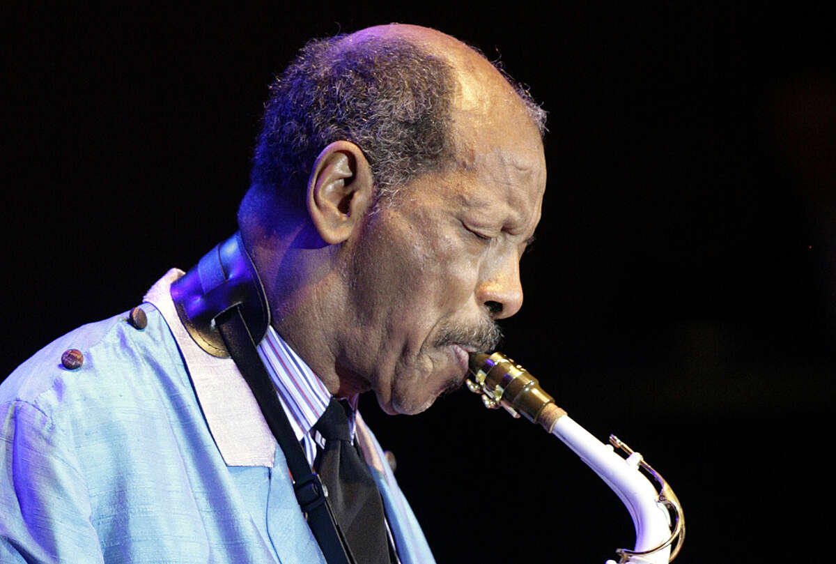 FILE - In this Wednesday, Feb. 14, 2007, file photo, U.S. jazz legend Ornette Coleman plays the sax during his only concert in Germany at the philharmonic concert house in Essen, Germany. Coleman, the visionary saxophonist who pioneered
