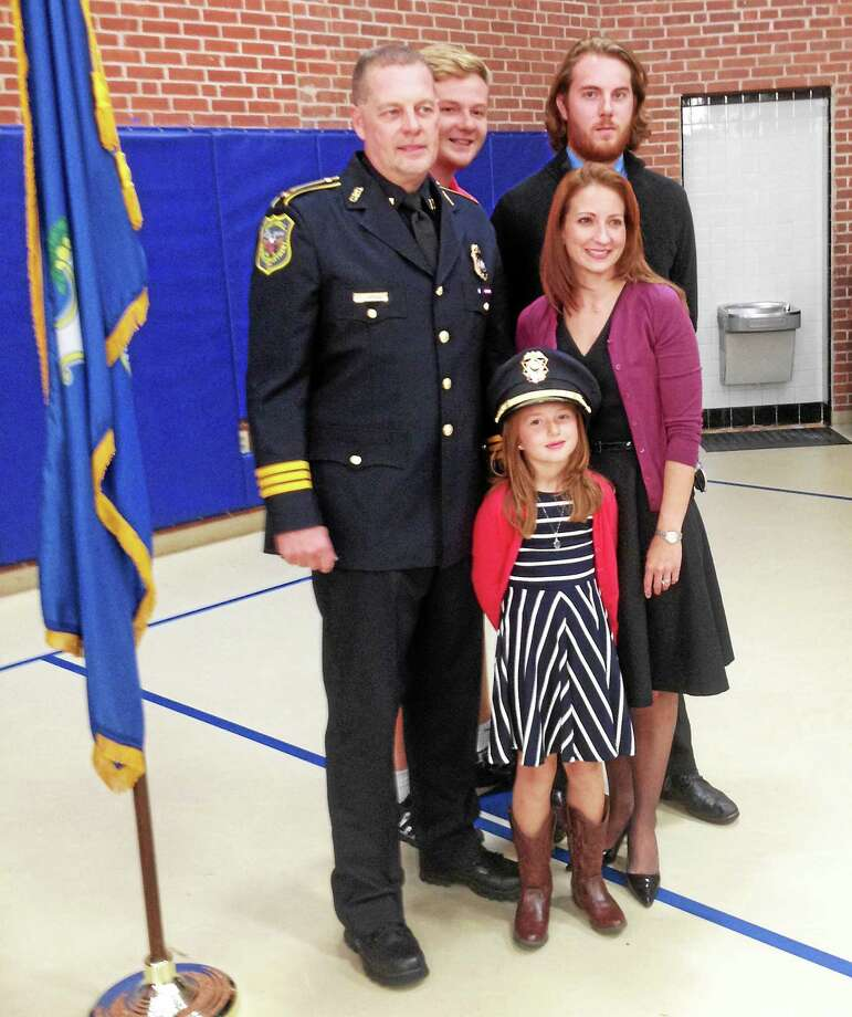 Det. Kevin VanderSloot was sworn in as a Cromwell police captain on Monday in a ceremony that drew nearly 100 people. Shown are, from left, VanderSloot, son Austin, daughter Grace, 6, wife Michell, and son Tyler. Photo: Jeff Mill — The Middletown Press