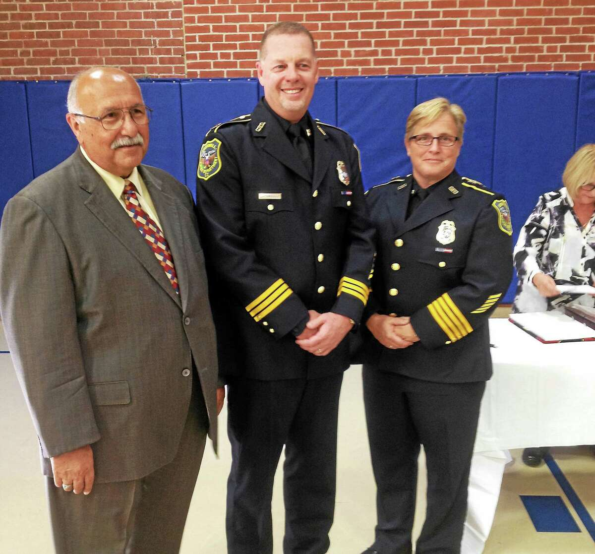 VanderSloot is flanked on the left by Cromwell Town Manager Anthony Salvatore, and on the right by Police Chief Denise Lamontagne.