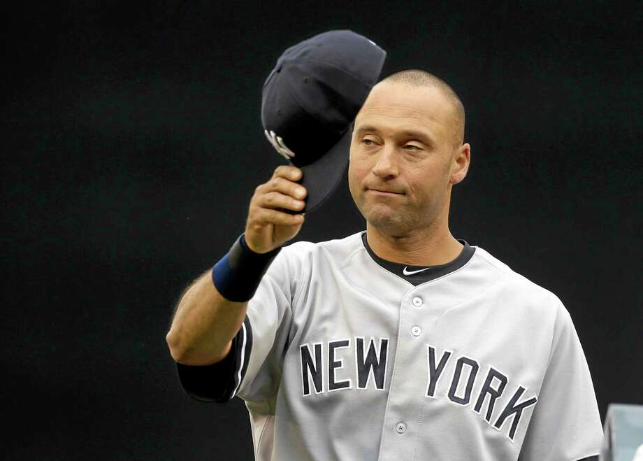 New York Yankees shortstop Derek Jeter tips his cap to the Seattle fans as he his honored during a pregame ceremony before Tuesday's game against the Mariners. Photo: Ted S. Warren — The Associated Press  / AP
