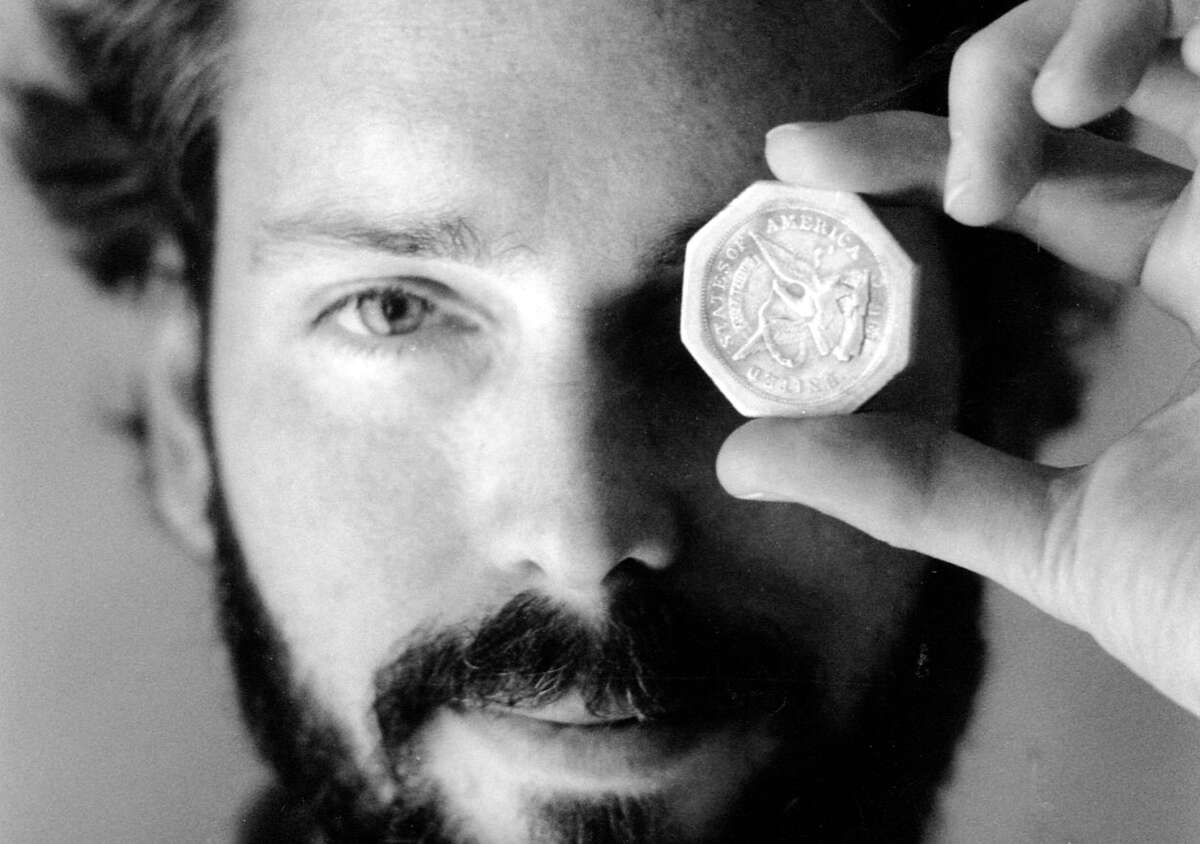 In this November 1989 photo, Tommy Thompson holds a $50 pioneer gold piece retrieved earlier in 1989 from the wreck of the gold ship Central America.