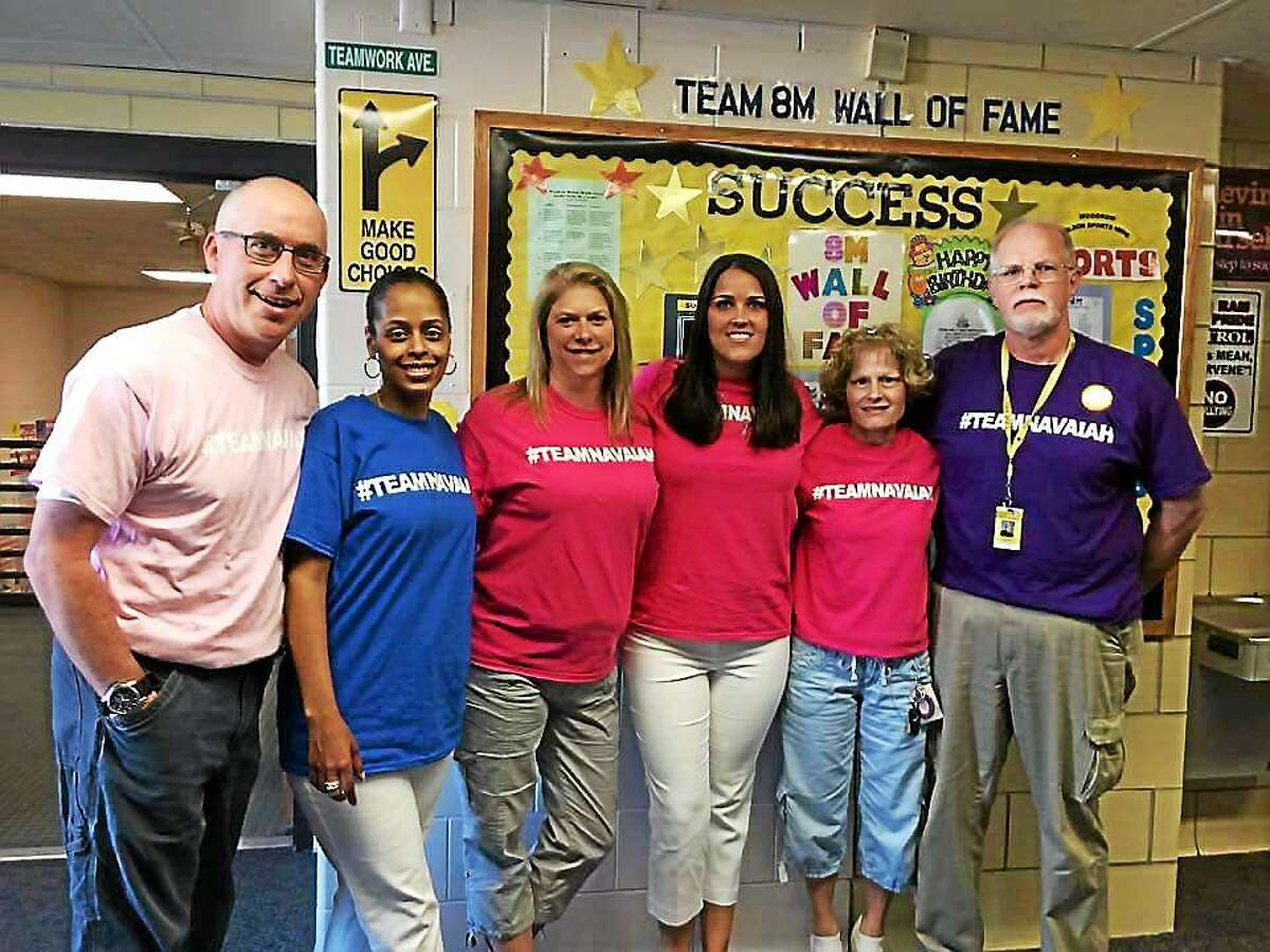 Staff at the middle school are selling T-shirts to raise money to help Navaiah Fulk's family during a financially challenging time. From left are: Peter VanVliet, Sheila Morris, Kelley Matzek-Cook, Meghan Mahon, Judy Kolenda and John Geary.