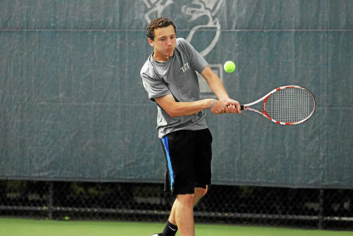 Xavier freshman Richard Ciamarra delivers a backhand during his straight set win in the State Open finals at Yale.