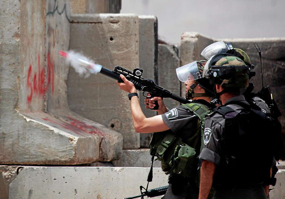 An Israeli border police officer fires a tear gas canister during clashes with Palestinians on June 4, 2014. Photo: AP Photo/Majdi Mohammed  / AP