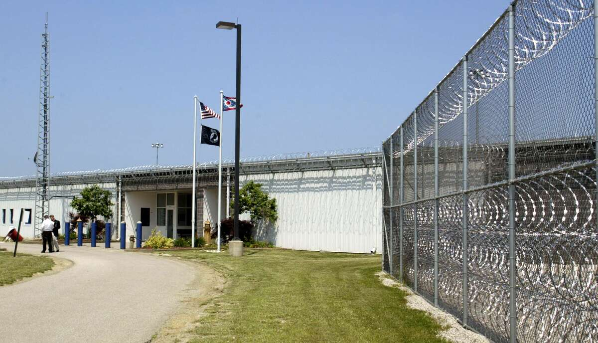 FILE- In this June 9, 2005 file photo, razor wire lines the fences and main building of the Lake Erie Correctional Institution in Conneaut, Ohio. The status of the nation's first privately-owned state prison is up for debate Wednesday, May 20, 2015, in Ohio as litigation brought on behalf of union workers displaced by the historic sale is argued before the state's high court. The Ohio Civil Service Employees Association sued Ohio in 2011 after Republican Gov. John Kasich and the GOP-controlled state Legislature passed a biennial budget bill authorizing the sale of Lake Erie Correctional Facility in Conneaut, along the shores of Lake Erie, and placing a second state prison under private management.