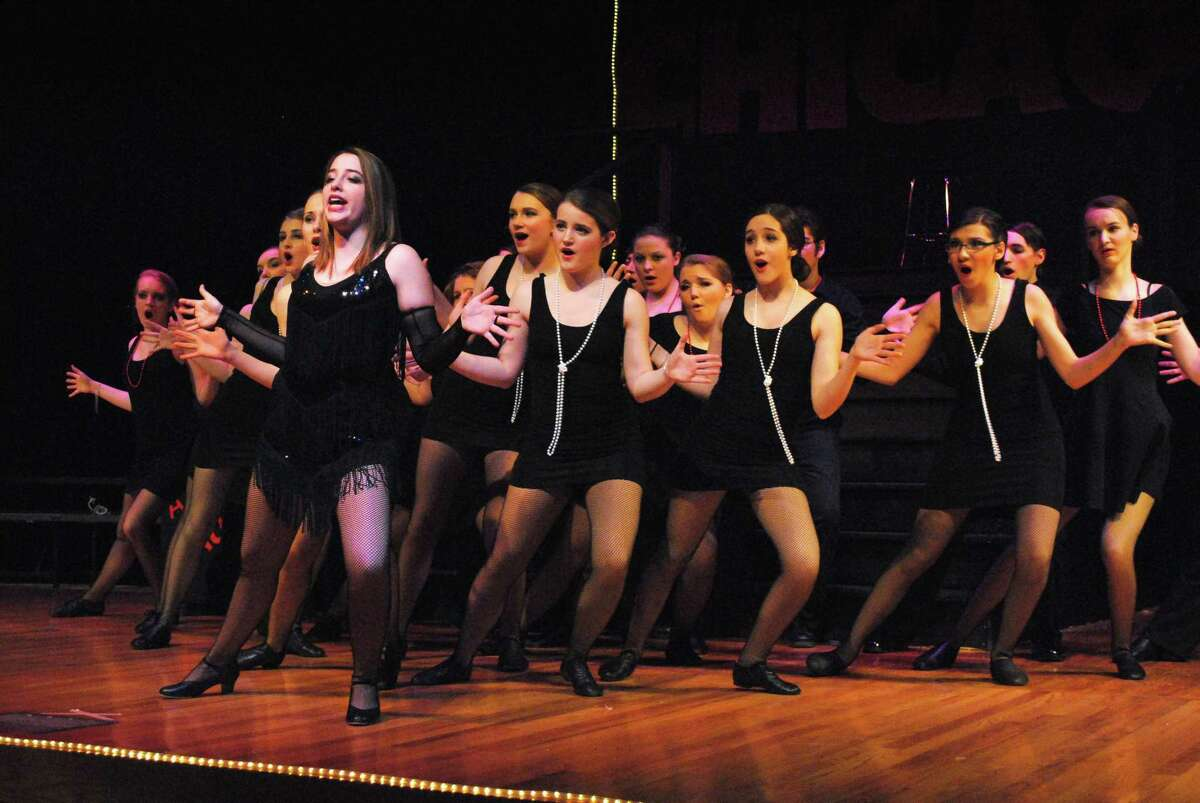 Velma, played by Alex Colavecchio, leads a group in one of the numbers at the begining of dress rehearsal for Chicago at Cromwell High School. John Berry - The Middletown Press