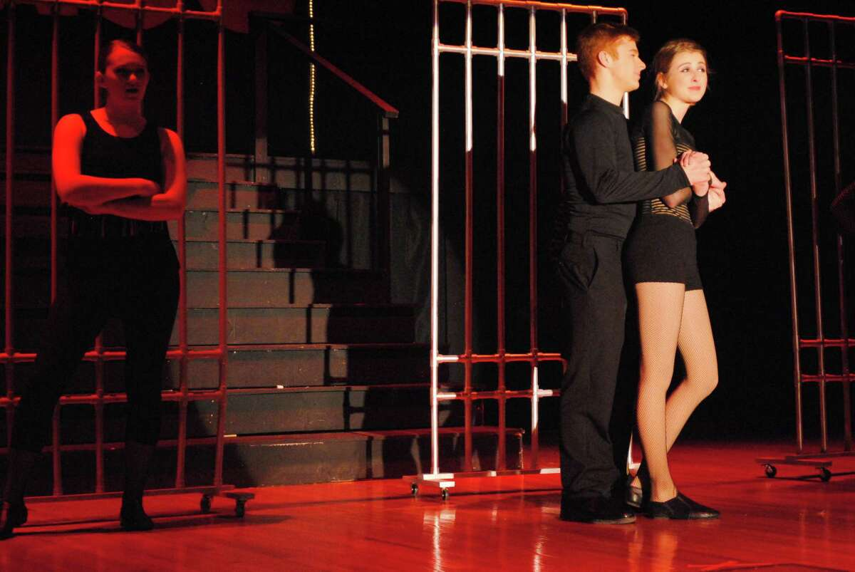 Bradey Malave plays Fred Casely and Cara McNeff plays Annie in the Cromwell High School production of Chicago. John Berry - The MiddletownPress