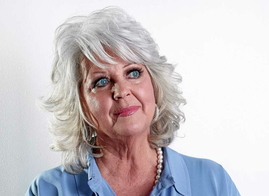 FILE - In this Jan. 17, 2012 file photo, celebrity chef Paula Deen poses for a portrait in New York. Paula Deen Ventures, a new company formed to help launch a comeback for Deen, on Wednesday, June 11, 2014, announced plans for the creation of the Paula Deen Network. The paid subscription-based network is set to launch in September and will be accessible by computer, smartphone or tablet. (AP Photo/Carlo Allegri, File) Photo: AP / R-Allegri