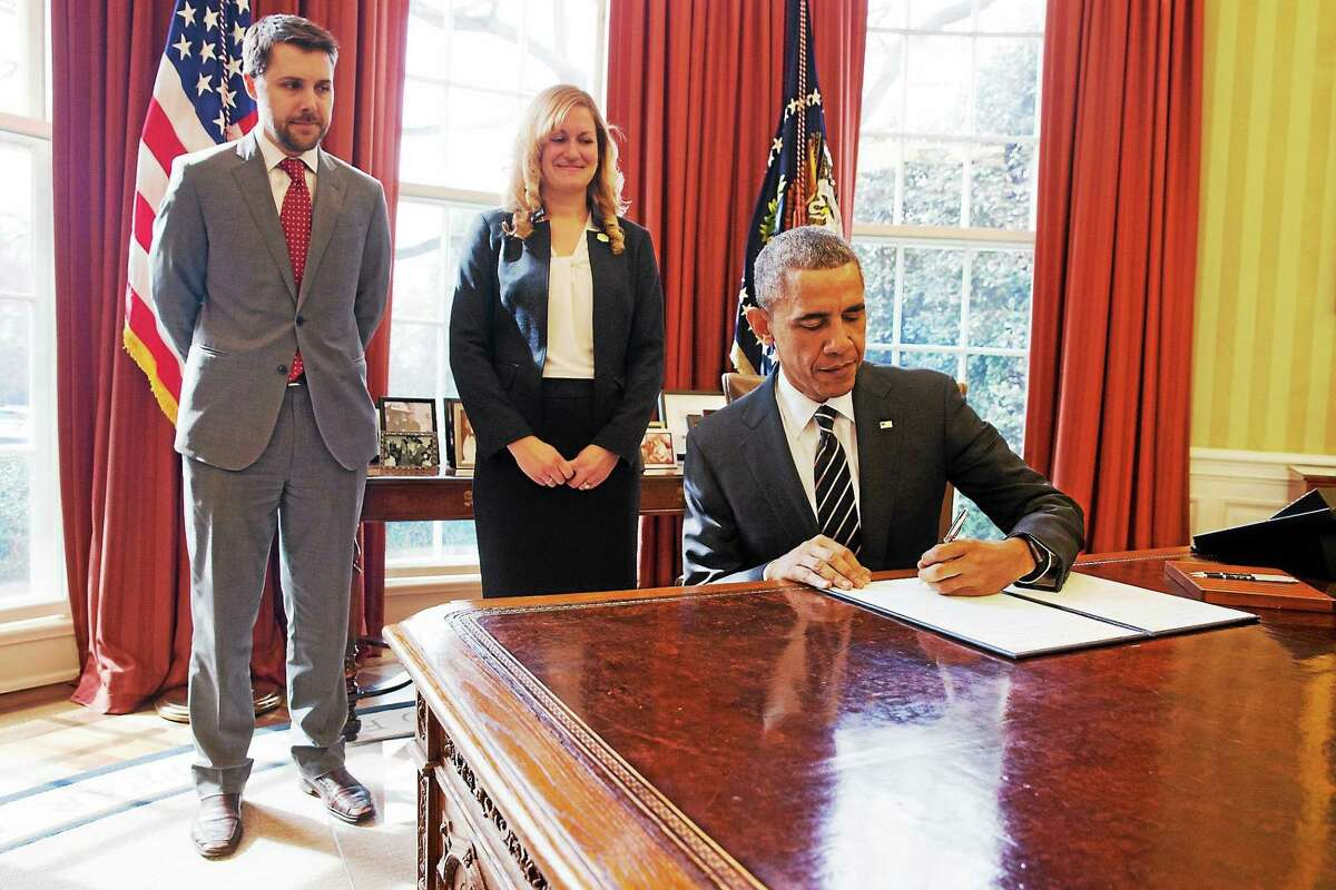 """President Barack Obama signs an executive order on March 19, 2015 entitled """"Planning for Sustainability in the Next Decade,"""" which aims to cut the federal governmentís greenhouse gas (GHG) emissions over the next decade."""