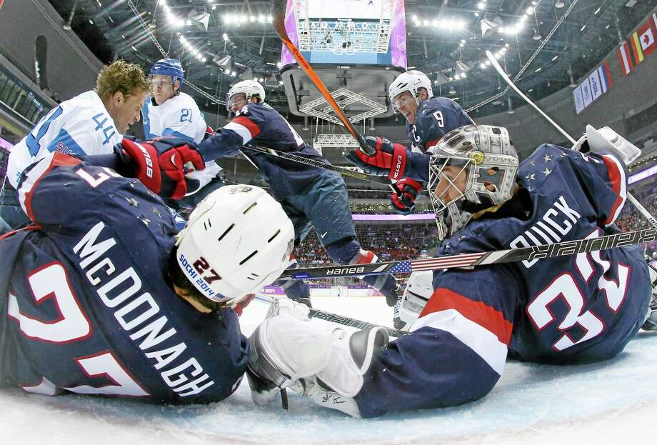 Team USA goaltender Jonathan Quick of Hamden and defenseman Ryan McDonagh (27) block a shot by Finland defenseman Kimmo Timonen during Saturday's bronze-medal game in Sochi, Russia. Register sports columnist Chip Malafronte points out there's a real possibility of pros not being involved in the 2018 Winter Games, but he feels Americans will still rally around whoever ends up wearing the Team USA sweaters in Pyeongchang, South Korea. Photo: Bruce Bennett — The Associated Press  / Pool Getty Images