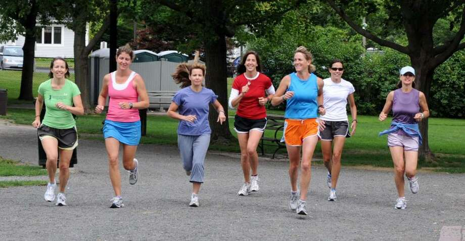 The Ridgefield Racy Ladies go for a run at Ballard Park in Ridgefield on Wednesday, June 16, 2010. From left, Deb Povinelli, Jacque Lang, Lisa Haden, Noreen Papa, Megan Searfoss, Sue Fleming and Kristen Hoban. They're all from Ridgefield. Photo: Lisa Weir / The News-Times Freelance