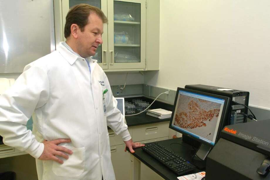 Dr. Cristiano Ferlini, of Danbury Hospital, examines an image of a cancer cell at the new Danbury Hospital Lab Thursday, June 17, 2010. Photo: Chris Ware / The News-Times