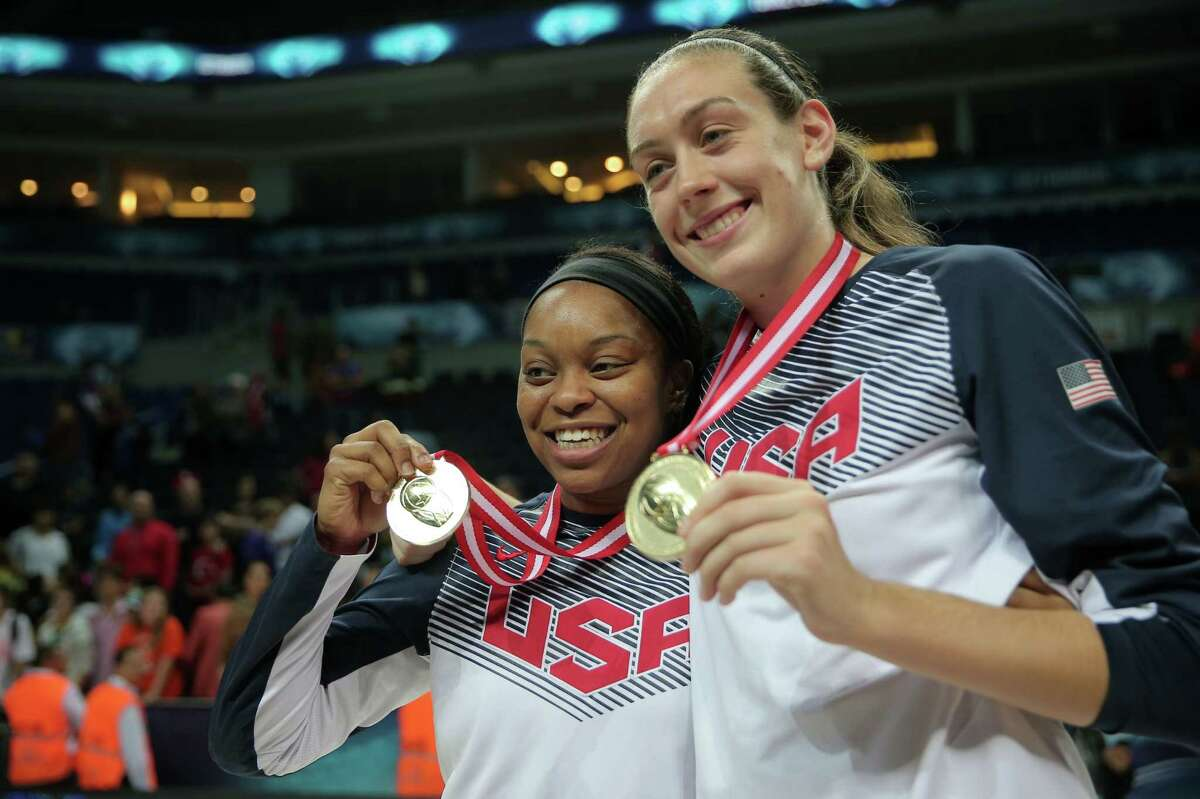 UConn's Breanna Stewart, right, poses with her gold medal and USA teammate Odyssey Sims on Sunday.