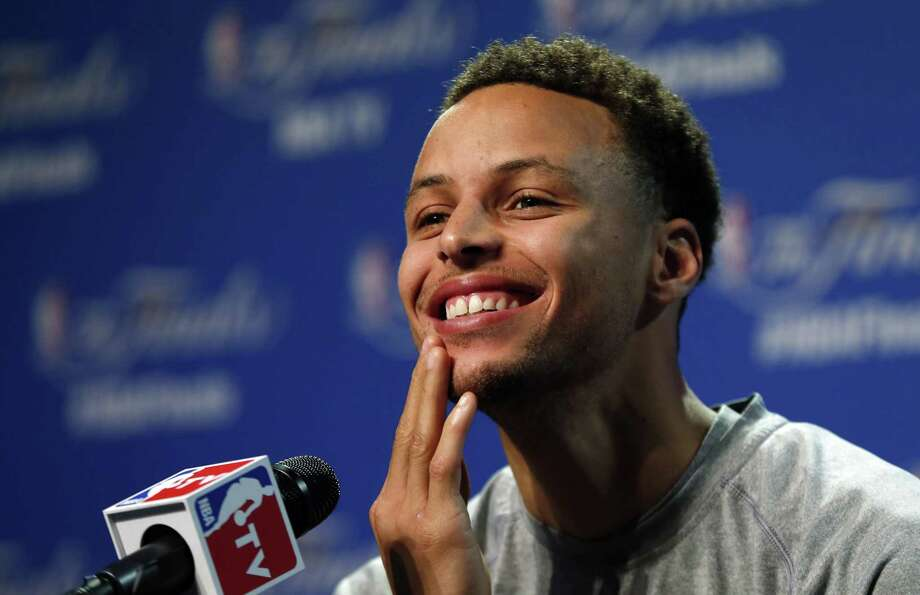 Golden State Warriors guard Stephen Curry answers a question during press conference Wednesday in Cleveland. Photo: Paul Sancya — The Associated Press  / AP