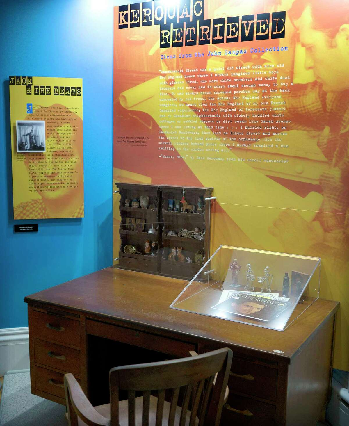 """In this Sept. 18, 2015, photo provided by the University of Massachusetts, Lowell, some of author Jack Kerouac's belongings, including a Frank Sinatra album and collection of figurines, are displayed on the desk where he once wrote, in the exhibit """"Kerouac Retrieved: Items from the John Sampas Collection,"""" at the university in Lowell, Mass. The exhibit opens in Kerouac's hometown on Oct. 8."""