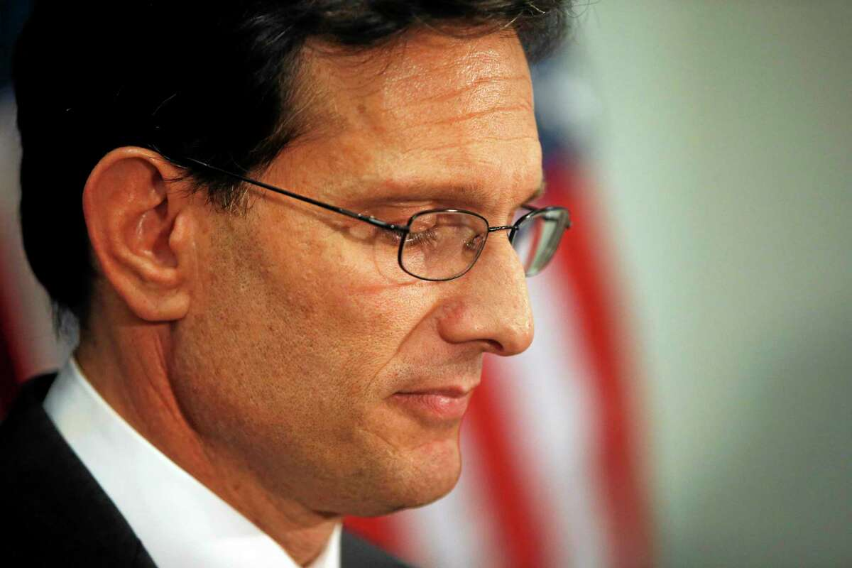 House Majority Leader Eric Cantor, R-Va., speaks to reporters after a House Republican caucus meeting on Capitol Hill in Washington, Wednesday, June 11, 2014. Repudiated at the polls, Cantor intends to resign his leadership post at the end of next month, officials said, clearing the way for a potentially disruptive Republican shake-up just before midterm elections with control of Congress at stake. (AP Photo/Charles Dharapak)