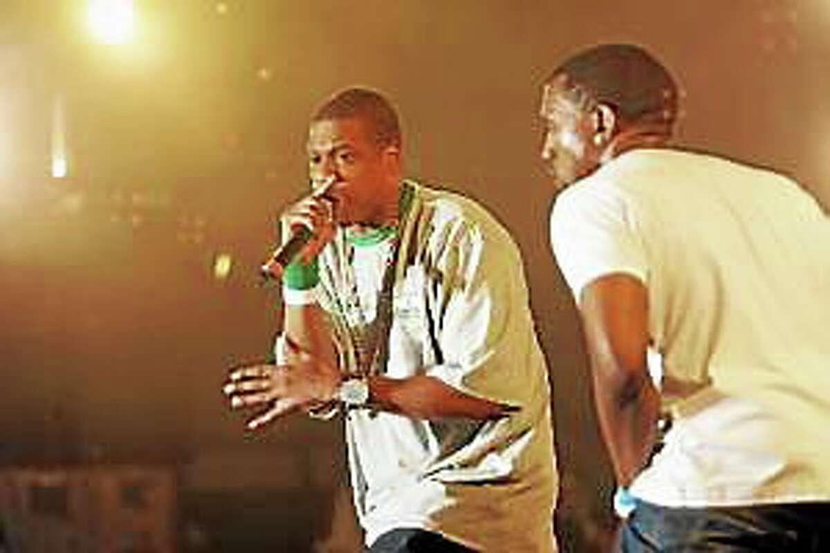 Jay-Z, left, performs with Kanye West during Hot 97 Summer Jam 2005 at Giants Stadium in East Rutherford, N.J. Sunday, June 5, 2005.