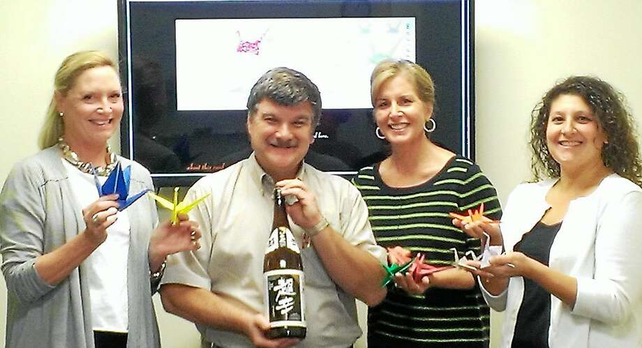 Submitted photo ó Community Music School  From left, Lisa LeMonte, Guilford Savings Bank and CMS Trustee; Ron Plebiscito, Angelini Wine, Ltd.; Renee Angelini, CMS Trustee; and Robin Andreoli, CMS executive director, look forward to welcoming guests at a Night of 1,000 Cranes on Oct. 18. Photo: Journal Register Co.
