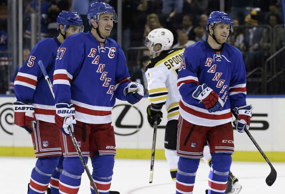 New York Rangers defenseman Ryan McDonagh (27) celebrates after scoring a goal against the Boston Bruins during the second period of an NHL preseason hockey game at Madison Square Garden in New York, Wednesday, Sept. 30, 2015. (AP Photo/Adam Hunger) Photo: AP / FR110666 AP