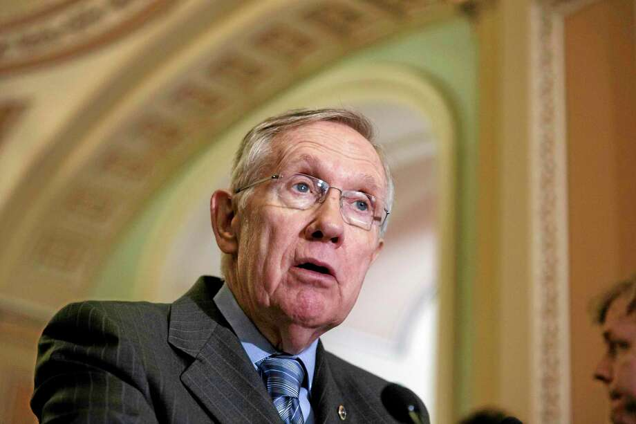 Senate Majority Leader Harry Reid of Nev. speaks to reporters on Capitol Hill in Washington, Tuesday, June 10, 2014, after a Democratic caucus lunch. Responding to the public outcry over lax care at Veterans Affairs health facilities, leaders of both parties plan debate soon on a bill to help vets waiting for months to get medical appointments. The House of Representatives advanced a VA reform bill today that passed 421-0.    (AP Photo/J. Scott Applewhite) Photo: AP / AP
