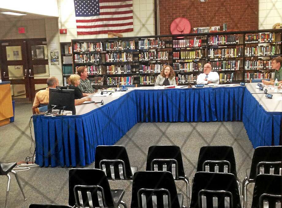The East Hampton school board meets in executive session to review the job performance of Superintendent Diane Dugas. Photo: Jeff Mill — The Middletown Press