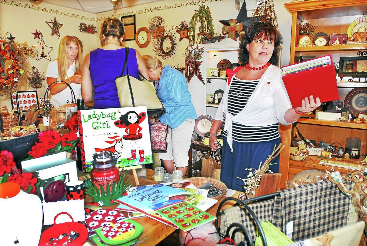 "The late Liz Warner is shown during ""Cash Mob"" at Ladybug Boutique at 122 College Street in Middletown in this 2012 file photo."