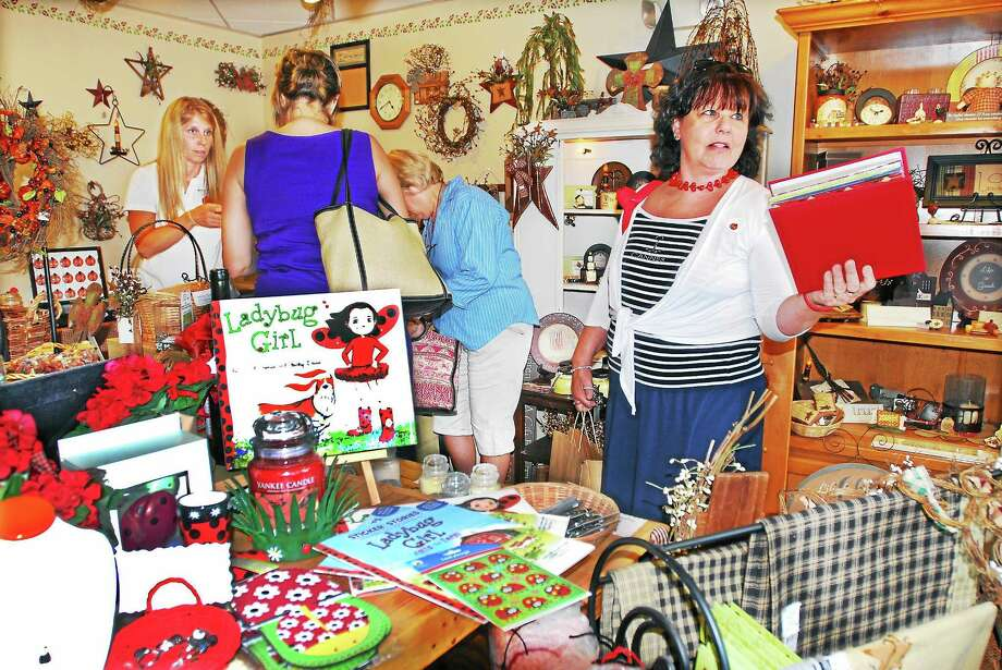 "The late Liz Warner is shown during ""Cash Mob"" at Ladybug Boutique at 122 College Street in Middletown in this 2012 file photo. Photo: File Photo  / a"