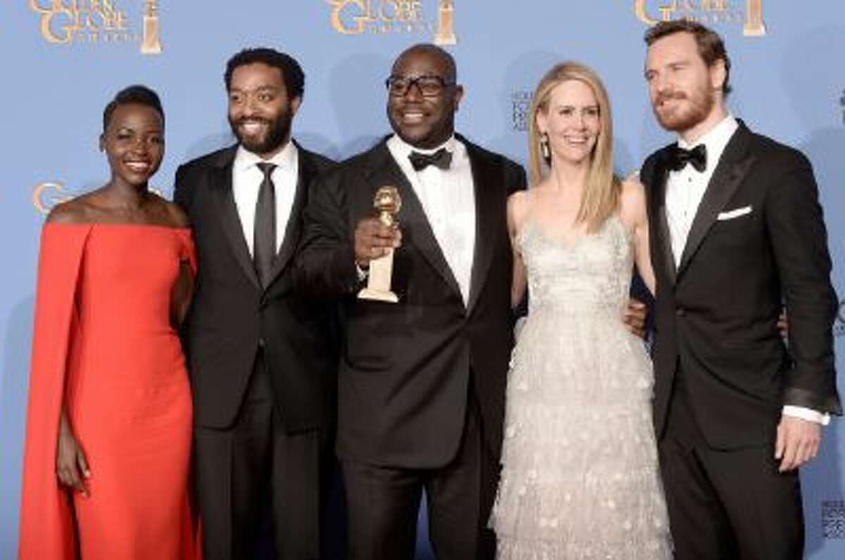 Cast and producers of '12 Years a Slave,' winners of Best Motion Picture - Drama, pose in the press room during the 71st Annual Golden Globe Awards.