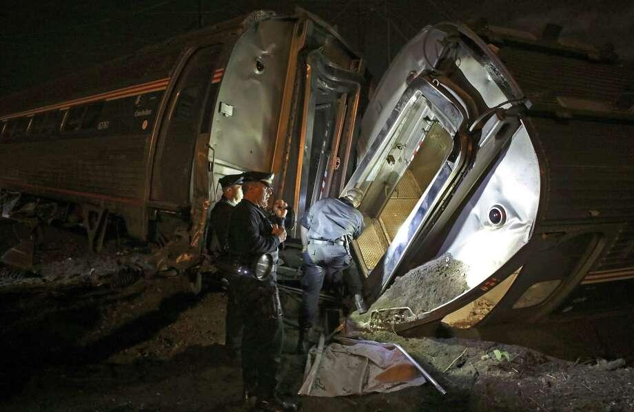 In this May 12, 2015 photo, emergency personnel work the scene of a train wreck in Philadelphia. Photo: AP Photo/Joseph Kaczmarek, File  / FR109827 AP