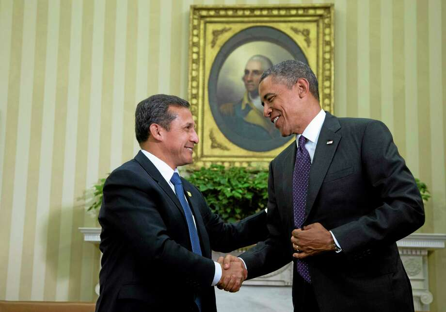 President Barack Obama greets his Peruvian counterpart Ollanta Humala in the Oval Office of the White House in Washington in this 2013 file photo. Both leaders discussed the Agreement Trans-Pacific Strategic Economic Partnership. Photo: AP File Photo  / AP