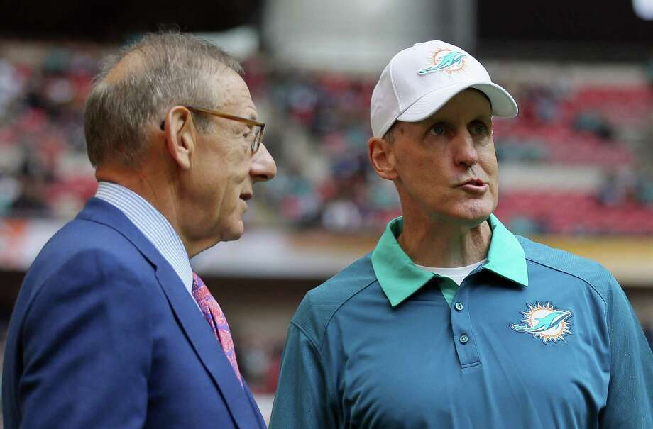 In this file photo from October, Miami Dolphins owner Stephen Ross, left, and Miami Dolphins head coach Joe Philbin chat during warm-ups. Philbin was fired Monday. Photo: The Associated Press File Photo  / AP