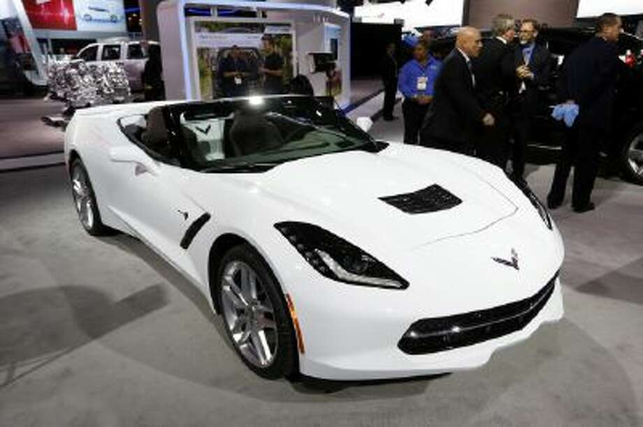 The Chevrolet Corvette Stingray has been named North American Car of the Year while the Chevrolet Silverado has been named North American Truck of the Year at the North American International Auto Show in Detroit, Monday, Jan. 13, 2014.