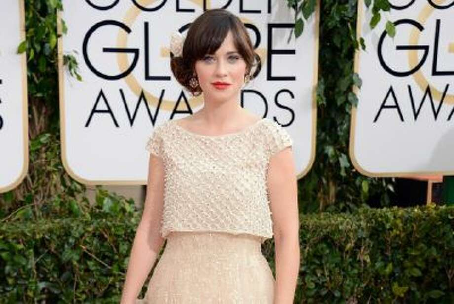 Love Zooey Deschanel and the side-swept hairdo but hate this dress and overall look.
