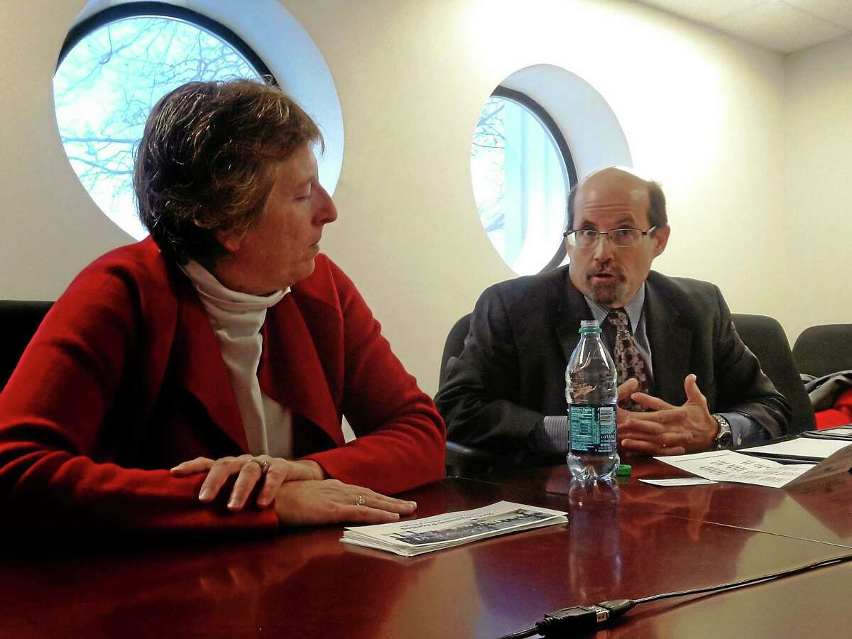 (Helen Bennett - New Haven Register) Connecticut Association of Boards of Education Executive Director Robert Rader makes a point during a meeting with the New Haven Register Editorial Board CABE general counsel and Deputy Director Patrice A. McCarthy is at left.