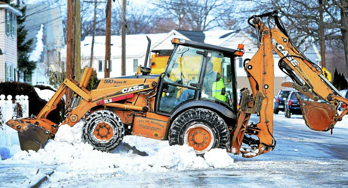 Milford Public Works clears snow on Naugatuck Avenue in Milford Friday.
