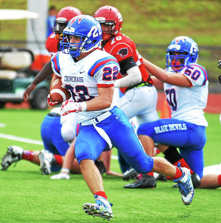 Coginchaug's Parker Tregoning rushed for 410 yards with six touchdowns to lead the Blue Devils past Windsor Locks/Suffield/East Granby, 46-14, on Saturday. Photo: Jimmy Zanor – The Middletown Press