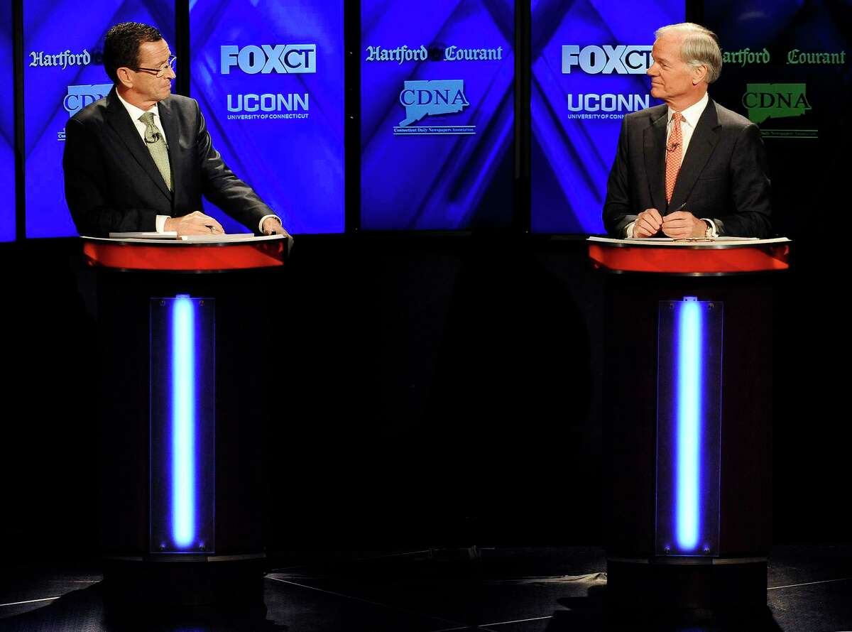 Incumbent Democrat Gov. Dannel P. Malloy, left, and Republican candidate for governor Tom Foley, debate at the University of Connecticut, Thursday, Oct. 2, 2014, in Storrs, Conn. (AP Photo/Jessica Hill)