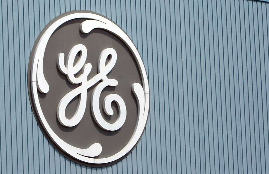 This June 24, 2014 photo shows the General Electric logo at a plant in Belfort, eastern France. Photo: AP Photo/Thibault Camus, File  / AP