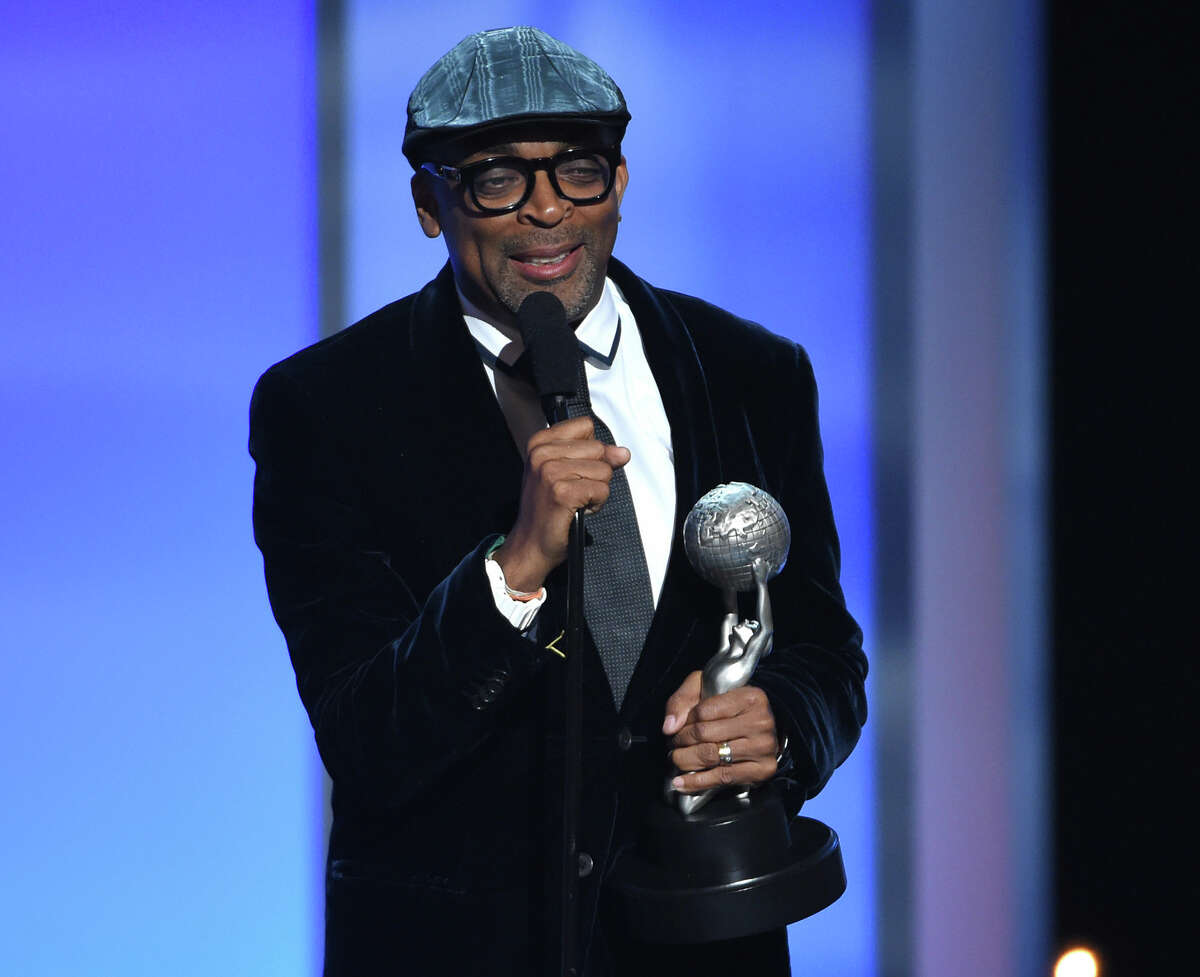 In this Feb. 6, 2015 photo, Spike Lee accepts the President's Award on stage at the 46th NAACP Image Awards at the Pasadena Civic Auditorium in Pasadena, Calif. Filmmaker, teacher, honorary Oscar winner, and crazy New York sports fan Lee is the next grand marshal of the New York City Marathon, race officials announced Monday, Oct. 5, 2015.